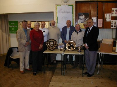 Geoffrey and June display their Trophies to some fellow members. lbpspe002.jpg 400 x 300