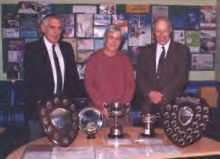 Geoffrey Williams, June Williams and Society president John Reid display trophy's won at the East Midland and East Anglian Philatelic Convention, 2000